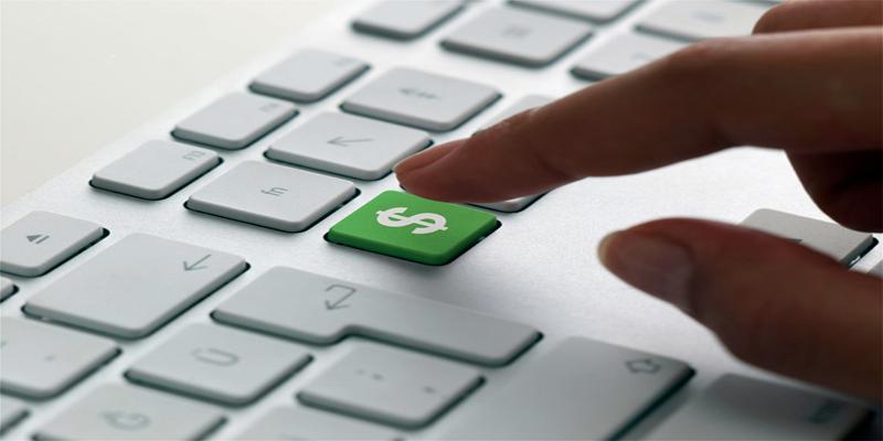 Imagem de um teclado com um cifrão no lugar da tecla.